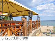Купить «Кафе на берегу моря», фото № 3840808, снято 8 сентября 2012 г. (c) Наталия Попова / Фотобанк Лори