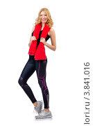 Купить «Девушка в спортивной форме и с красным полотенцем на шее стоит на белом фоне», фото № 3841016, снято 12 июня 2012 г. (c) Elnur / Фотобанк Лори