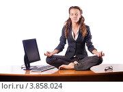 Купить «Женщина медитирует сидя на офисном столе, белый фон», фото № 3858024, снято 29 августа 2012 г. (c) Elnur / Фотобанк Лори