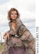 Купить «Молодая женщина в шёлковом платье», фото № 3861116, снято 3 сентября 2011 г. (c) Сергей Фастов / Фотобанк Лори