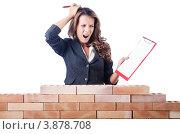 Купить «Озадаченная женщина-строитель с планшетом», фото № 3878708, снято 27 июля 2012 г. (c) Elnur / Фотобанк Лори