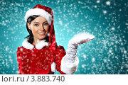 Купить «Снегурочка подставляет ладонь падающим снежинкам», фото № 3883740, снято 27 сентября 2012 г. (c) Sergey Nivens / Фотобанк Лори