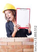 Купить «Женщина-инженер в строительной каске показывает планшет», фото № 3893512, снято 27 июля 2012 г. (c) Elnur / Фотобанк Лори