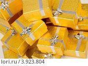 Купить «Золотые коробки с серебряной ленточкой на праздник в подарок», фото № 3923804, снято 18 августа 2012 г. (c) Tatjana Romanova / Фотобанк Лори