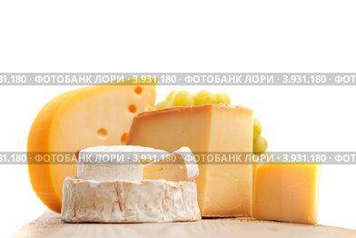 Купить «Различные сыры на деревянной доске», фото № 3931180, снято 20 августа 2012 г. (c) Иван Михайлов / Фотобанк Лори