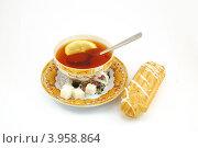 Чашка чая и пирожное. Стоковое фото, фотограф Анна Момот / Фотобанк Лори