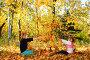 Купить «Девочки играют осенними листьями в парке», фото № 3960736, снято 17 октября 2012 г. (c) Сергей Галушко / Фотобанк Лори