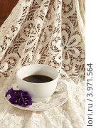 Чашка кофе на кружевной ткани. Стоковое фото, фотограф Чуракова Анна / Фотобанк Лори