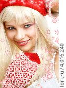 Купить «Привлекательная девушка с длинными волосами в колпаке Санты-Клауса в варежках на белом фоне  со снежинками», фото № 4016240, снято 14 августа 2006 г. (c) Syda Productions / Фотобанк Лори