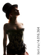 Купить «Силуэт стройной девушки в корсете и цилиндре на белом фоне», фото № 4016364, снято 30 сентября 2009 г. (c) Syda Productions / Фотобанк Лори