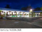 Купить «Двор гостиницы Panglao Regents Park вечером», фото № 4034368, снято 10 мая 2012 г. (c) Сергей Дубров / Фотобанк Лори