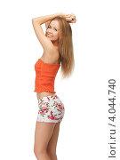 Купить «Юная симпатичная девушка в коротких шортах и топике на белом фоне», фото № 4044740, снято 25 июня 2012 г. (c) Syda Productions / Фотобанк Лори