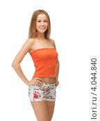 Купить «Юная симпатичная девушка в коротких шортах и топике на белом фоне», фото № 4044840, снято 25 июня 2012 г. (c) Syda Productions / Фотобанк Лори
