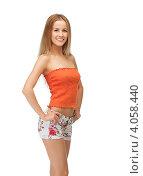 Купить «Привлекательная юная девушка с русыми волосами в шортах на белом фоне», фото № 4058440, снято 25 июня 2012 г. (c) Syda Productions / Фотобанк Лори