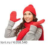 Купить «Юная девушка в вязаной красной шапке, шарфе и варежках на белом фоне», фото № 4058540, снято 30 октября 2011 г. (c) Syda Productions / Фотобанк Лори