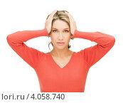 Купить «Несчастная блондинка в красном свитере схватилась за голову на белом фоне», фото № 4058740, снято 24 марта 2012 г. (c) Syda Productions / Фотобанк Лори