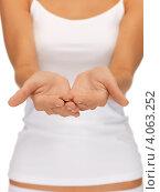 Купить «Женская стройная фигура с чем-то в ладонях на белом фоне», фото № 4063252, снято 16 сентября 2012 г. (c) Syda Productions / Фотобанк Лори