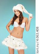 Купить «Жизнерадостная девушка с длинными волосами в серебристом колпаке Санты-Клауса и белой короткой юбке», фото № 4063408, снято 22 ноября 2011 г. (c) Syda Productions / Фотобанк Лори