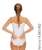 Купить «Юная девушка с косой и стройной фигурой в нижнем белье белого цвета на белом фоне», фото № 4063452, снято 16 сентября 2012 г. (c) Syda Productions / Фотобанк Лори