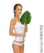 Купить «Юная девушка с косой и стройной фигурой в нижнем белье белого цвета с зеленым листом в руке на белом фоне», фото № 4063552, снято 16 сентября 2012 г. (c) Syda Productions / Фотобанк Лори