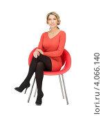 Купить «Деловая женщина в красном платье сидит на стуле на белом фоне», фото № 4066140, снято 24 марта 2012 г. (c) Syda Productions / Фотобанк Лори