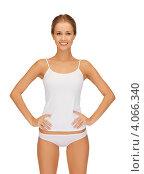 Купить «Портрет юной стройной привлекательной девушки в белом хлопковом белье на белом фоне», фото № 4066340, снято 16 сентября 2012 г. (c) Syda Productions / Фотобанк Лори