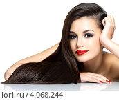 Купить «Красивая молодая женщина с длинными тёмными волосами и ярким макияжем на белом фоне», фото № 4068244, снято 20 ноября 2012 г. (c) Валуа Виталий / Фотобанк Лори