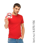 """Купить «Молодой человек показывает знак """"не курить"""" на белом фоне», фото № 4070156, снято 7 октября 2012 г. (c) Syda Productions / Фотобанк Лори"""