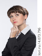 Купить «Деловая девушка задумалась», фото № 4073796, снято 1 декабря 2012 г. (c) Михаил Иванов / Фотобанк Лори