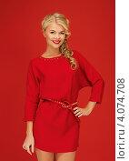 Купить «Портрет привлекательной блондинки в платье на красном фоне», фото № 4074708, снято 7 октября 2012 г. (c) Syda Productions / Фотобанк Лори