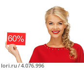 Купить «Молодая привлекательная блондинка в красном платье со знаком скидки на белом фоне», фото № 4076996, снято 7 октября 2012 г. (c) Syda Productions / Фотобанк Лори
