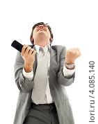 Купить «Бизнесмен в сером костюме разговаривает по мобильному телефону на белом фоне», фото № 4085140, снято 26 декабря 2006 г. (c) Syda Productions / Фотобанк Лори