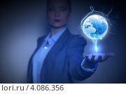 Купить «Красивая девушка в строгом деловом костюме держит на ладони парящий глобус - концепция глобальных технологий», фото № 4086356, снято 16 сентября 2012 г. (c) Sergey Nivens / Фотобанк Лори
