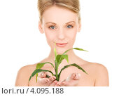 Купить «Привлекательная блондинка с зеленым растением в руках на белом фоне», фото № 4095188, снято 12 декабря 2009 г. (c) Syda Productions / Фотобанк Лори