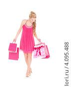Купить «Счастливая молодая женщина с пакетами в руках после удачного шоппинга», фото № 4095488, снято 17 октября 2009 г. (c) Syda Productions / Фотобанк Лори