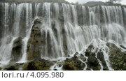 Купить «Водопад в национальном парке Jiuzhaigou, занесенном в реестр Всемирного Наследия ЮНЕСКО», видеоролик № 4095980, снято 8 декабря 2012 г. (c) Сергей Орлов / Фотобанк Лори