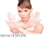 Купить «Привлекательная молодая женщина показывает на руках жест стоп на белом фоне», фото № 4107676, снято 22 ноября 2009 г. (c) Syda Productions / Фотобанк Лори