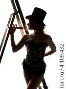 Купить «Силуэт девушки в корсете и щляпе со стремянкой», фото № 4109432, снято 30 сентября 2009 г. (c) Syda Productions / Фотобанк Лори