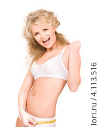 Купить «Стройная девушка в белом белье измеряет себя сантиметром», фото № 4113516, снято 21 ноября 2009 г. (c) Syda Productions / Фотобанк Лори