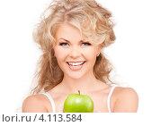 Купить «Молодая блондинка с твердым яблоком в руках на белом фоне», фото № 4113584, снято 21 ноября 2009 г. (c) Syda Productions / Фотобанк Лори