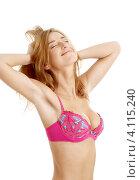 Купить «Девушка в розовом бюстгальтере потягивается на белом фоне», фото № 4115240, снято 7 апреля 2007 г. (c) Syda Productions / Фотобанк Лори