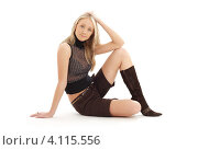 Купить «Длинноволосая девушка в черных высоких сапогах на каблуках», фото № 4115556, снято 11 марта 2007 г. (c) Syda Productions / Фотобанк Лори