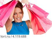 Купить «Довольная девушка с покупками в ярких пакетах в руках после шоппинга», фото № 4119688, снято 14 ноября 2009 г. (c) Syda Productions / Фотобанк Лори
