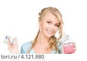 Купить «Счастливая молодая женщина с деньгами в руках», фото № 4121880, снято 26 сентября 2009 г. (c) Syda Productions / Фотобанк Лори