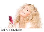 Купить «Жизнерадостная девушка с мобильным телефоном в руках на белом фоне», фото № 4121884, снято 21 ноября 2009 г. (c) Syda Productions / Фотобанк Лори