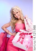 Купить «Довольная девушка с покупками в ярких пакетах в руках после шоппинга», фото № 4121988, снято 1 мая 2010 г. (c) Syda Productions / Фотобанк Лори