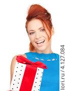Купить «Веселая девушка с подарком в руках на белом фоне», фото № 4127084, снято 14 ноября 2009 г. (c) Syda Productions / Фотобанк Лори