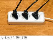 Купить «Электрический удлинитель», фото № 4164816, снято 28 декабря 2011 г. (c) Владимир Хаманов / Фотобанк Лори