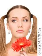 Купить «Привлекательная женщина с двумя хвостиками и цветком красного гербера», фото № 4170152, снято 6 июня 2010 г. (c) Syda Productions / Фотобанк Лори
