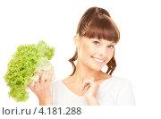 Купить «Счастливая девушка с челкой и зеленым салатом в руках на белом фоне», фото № 4181288, снято 27 июня 2010 г. (c) Syda Productions / Фотобанк Лори